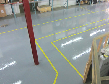 Industrial epoxy coating installation and safety lines installation - Concrete Polishing & Sealing Ltd.