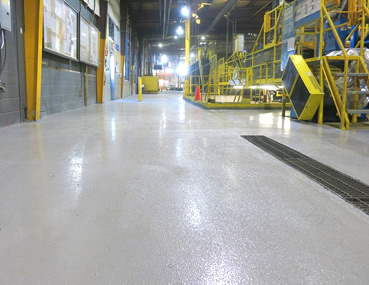 Industrial epoxy coating of concrete floor installation at CertainTeed Manufacturing Plant.