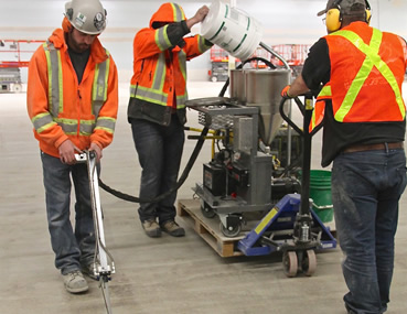 Concrete floor joint filling by Concrete Polishing and Sealing Ltd. Ottawa